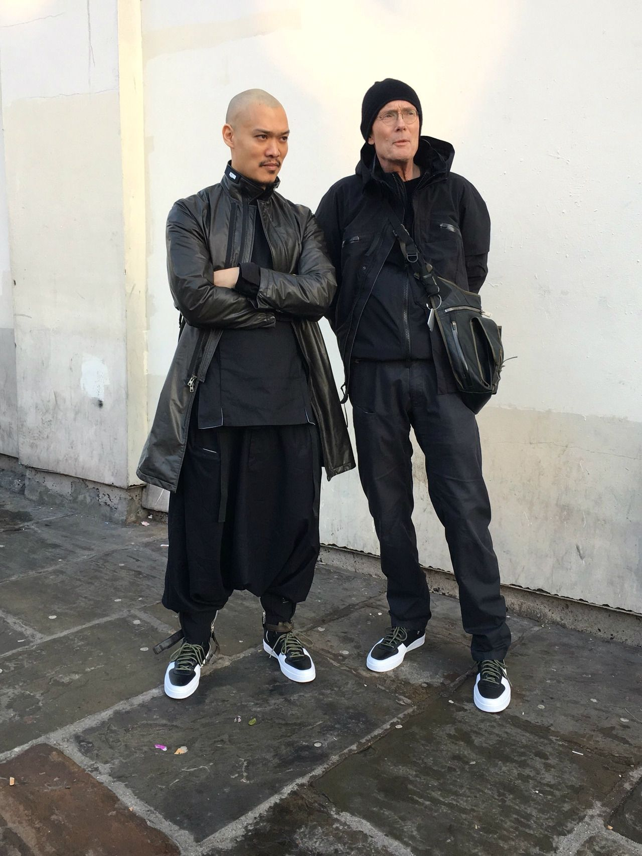 Hugh Errolson with William Gibson wearing Acronym gear in 2017
