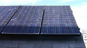 two SX170B 170 W solar panels on roof